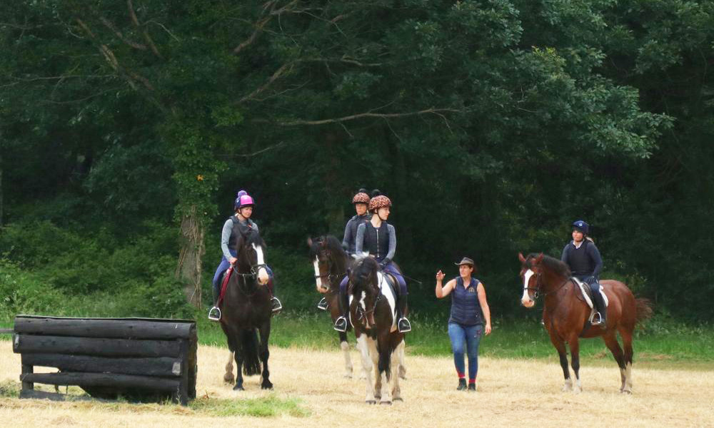 Discussing aproach to the next fence - cross country training at Bel-Air Ireland