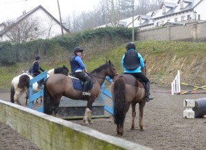 Jumping lesson in the arena at Bel-Air Ireland