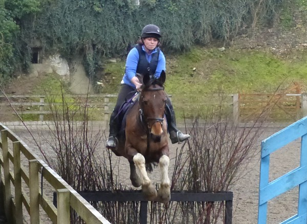 Riding Holiday - Cross-country lesson in the all-weather arena at Bel-Air Equestrian Centre